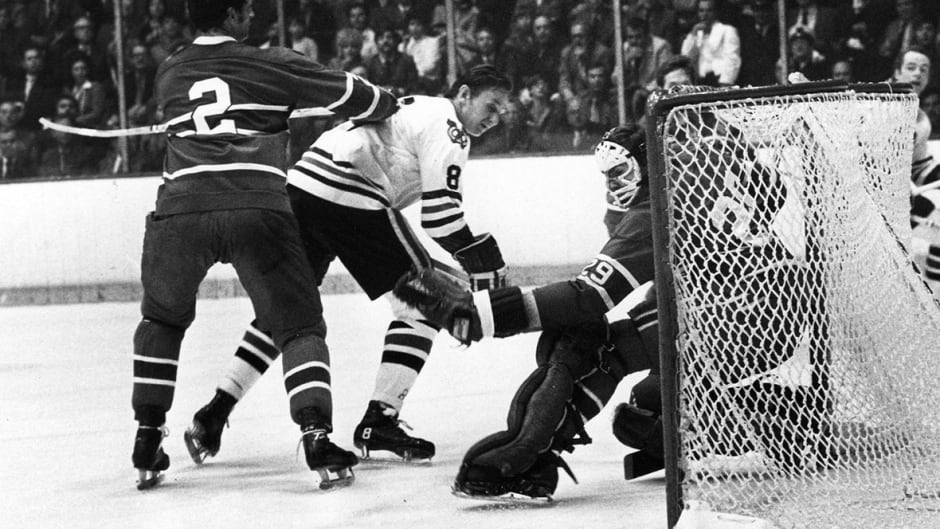 Montreal Canadiens' goalie Ken Dryden makes a save as teammate Jacques Laperriere (left) ties up Chicago Blackhawks' Jim Pappin during Stanley Cup playoff action in Chicago, May 5, 1971. (CP PHOTO/AP)