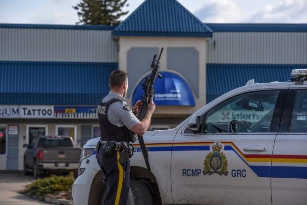 Officer with long gun