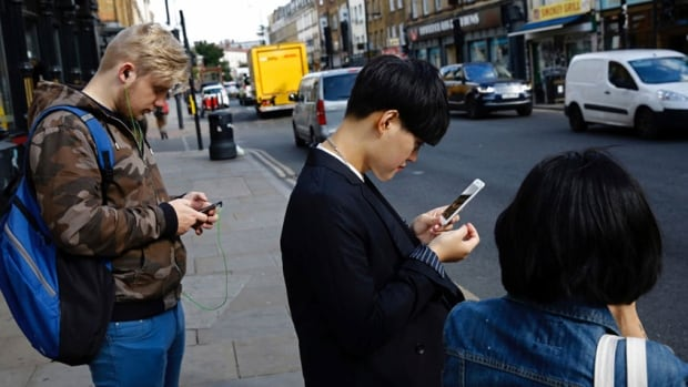 The angle at which people hold their heads while texting on a smartphone is causing widespread neck and upper back pain, specialists say.