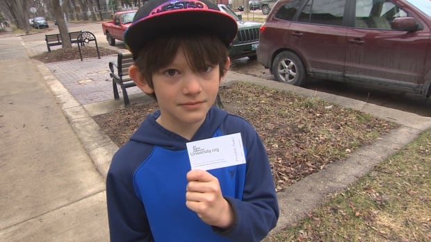 James Krieder his brother and friends were given $100 dollars and a strange business card while running a lemonade stand at the corner of Lipton Street and Westminster Avenue Thursday.