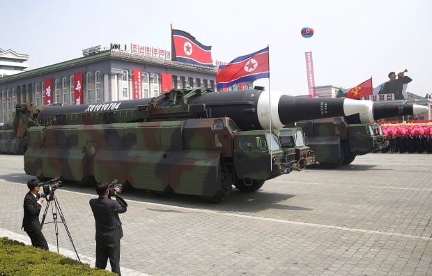 North Korea shows off new generation of ballistic missiles in military parade