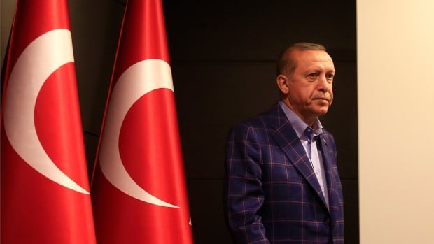Turkey's President Recep Tayyip Erdogan leaves a hall following a news briefing in Istanbul on Sunday. Speaking to reporters, Erdogan said unofficial results showed the 'yes' side had won by a margin of 1.3 million votes.