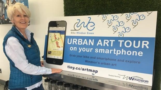 Jenn Escott shows off new urban art tour app.