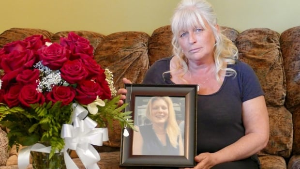 Carol Ward holds a photo of her daughter Lisa Erickson, 32, who she found after she overdosed on opioids. Ward believes the doctor who had been prescribing Erickson morphine for years is partly to blame for her death.