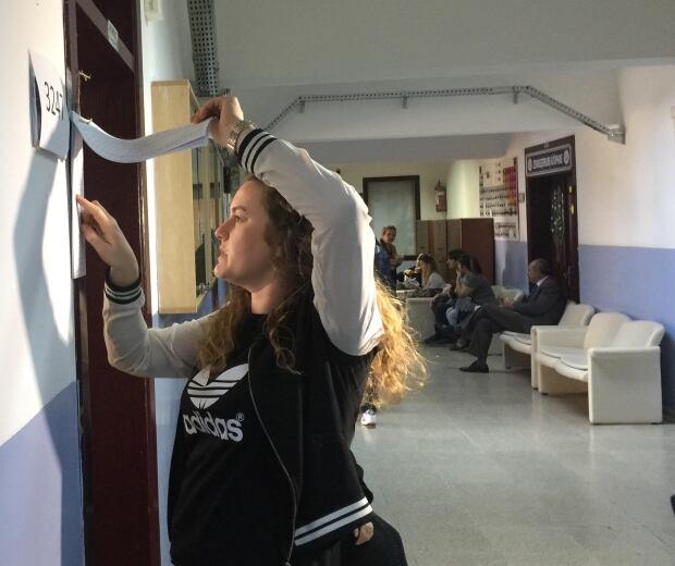 Woman checks name