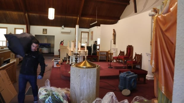 Members of the community were cleaning up the church Monday. They hope to reopen in a few days.