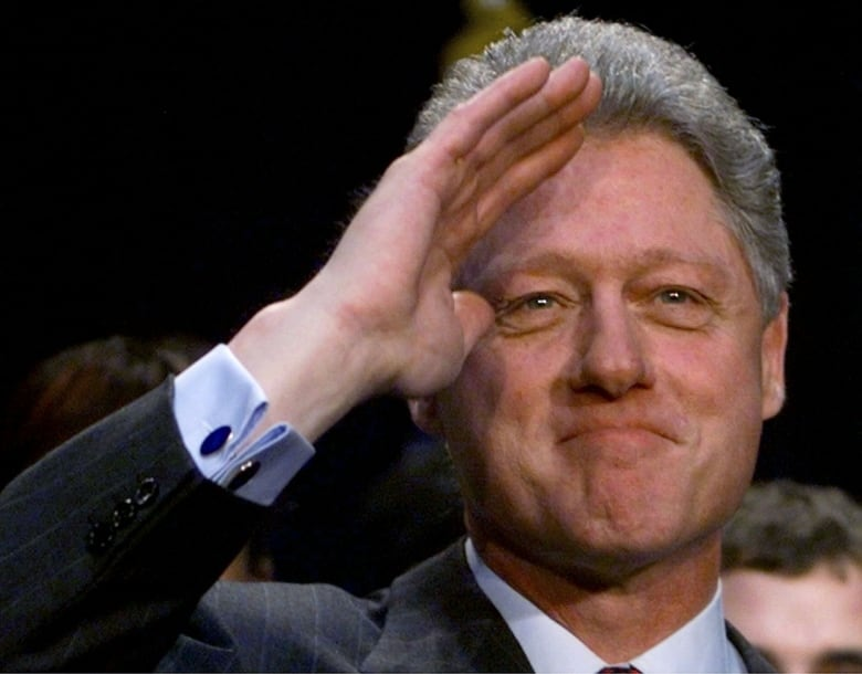 U.S. President Bill Clinton was impeached on perjury and obstruction of justice in 1998 in a House vote, though he was able to stay in office because a Senate trial never convicted him.(Win McNamee/Associated Press)