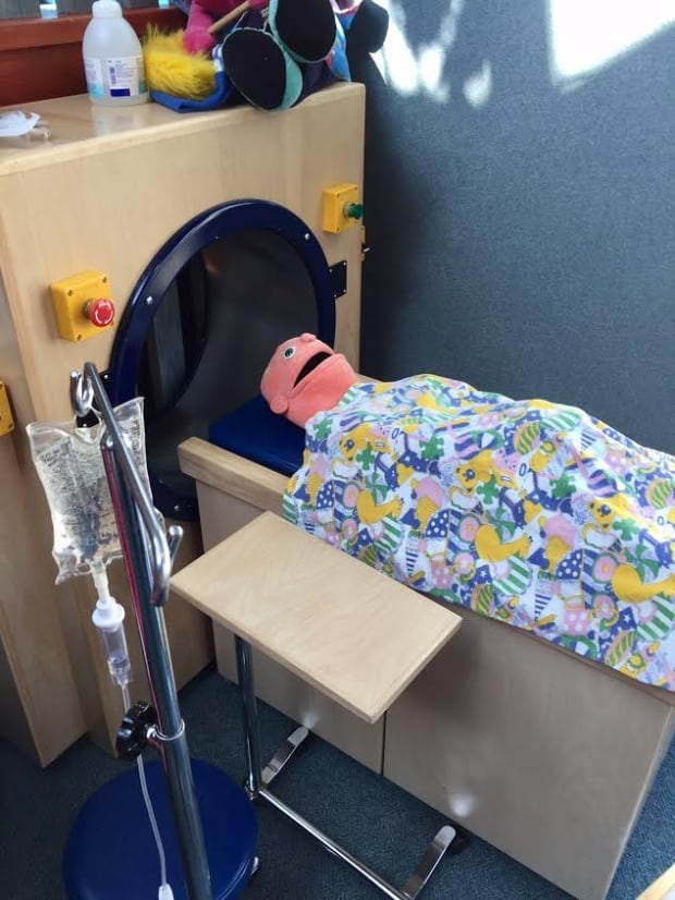 A Patient Puppet takes a turn in the toy MRI available for sick children to play with.