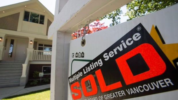 A sold sign is pictured outside a home in Vancouver, B.C., Tuesday, June 28, 2016.   Analysts say a 15-per-cent tax on foreign home buyers on Metro Vancouver homes - introduced last summer - has had little impact on affordability.