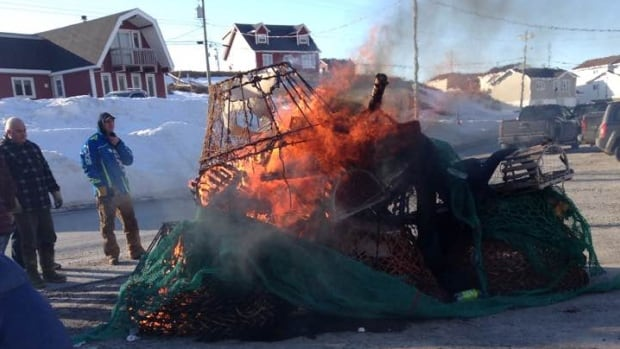 Fish harvesters burned gear in Port au Choix Tuesday saying it's of no use to them because of recent quota cuts.