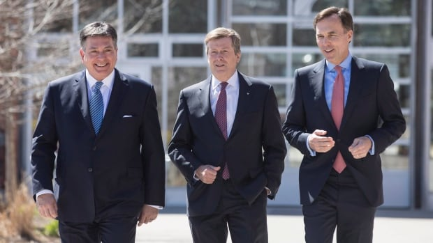 Federal Finance Minister Bill Morneau (right), Ontario Finance Minister Charles Sousa (left) and Toronto Mayor John Tory arrive for talks on the housing market in the Greater Toronto Area on Tuesday.