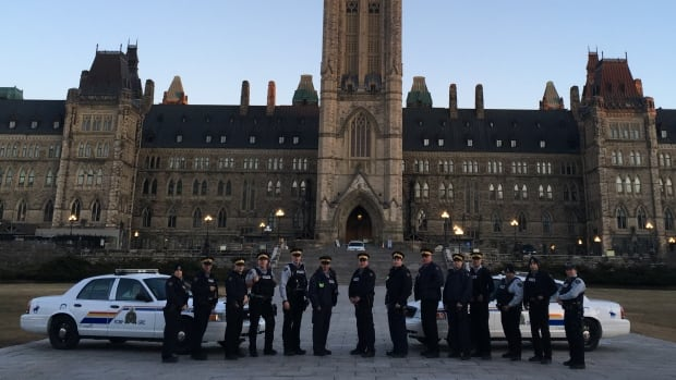 RCMP officers protesting working conditions and wages within the national police force pose on Parliament Hill on April 9 in a photo shared on social media. One of the organizations aiming to represent Mounties in collective bargaining has applied for union certification.