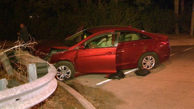 A car with multiple occupants and bullet holes crashed into a guardrail at Bayview and Lawrence early Wednesday morning.