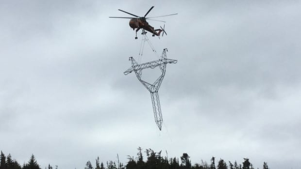 The first towers are airlifted for a new transmission line to the electrical generating station at Bay d'Espoir in the Newfoundland interior.