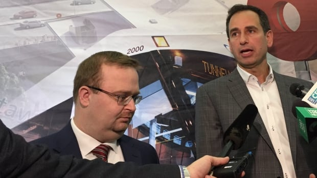 Coun. Stephen Blais, left, and Ottawa's general manager of transportation, John Manconi, have both refused to confirm whether light rail service will launch in Ottawa in May 2018 — the date mentioned in the city's contract with the Rideau Transit Group.