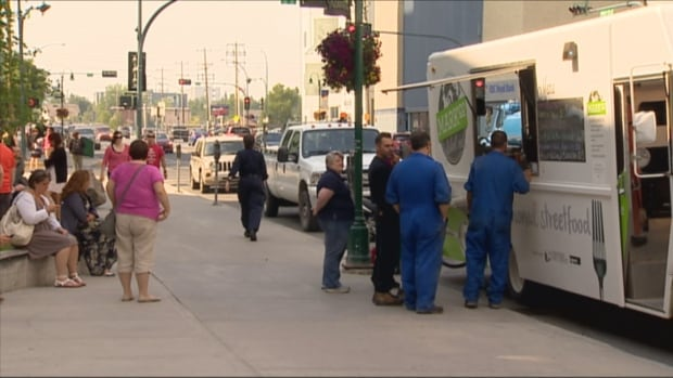 Yellowknife residents flock to food trucks in the city's downtown during the summer months. One food truck owner is asking the city to create more permanent homes for the trucks, reducing the amount of jostling for position between food truck operators and drivers for downtown parking spaces.