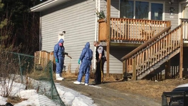 Officials wearing protective gear could be seen entering the residence on Wednesday morning.