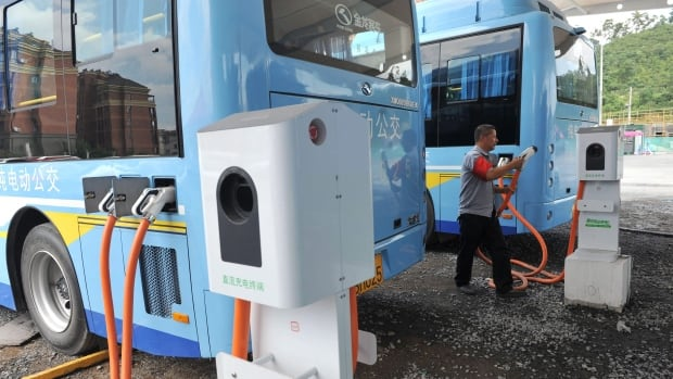 A driver charges an electric bus in Lin'an City in China. A pilot program could see TransLink get four electric battery-powered buses for a pilot program.