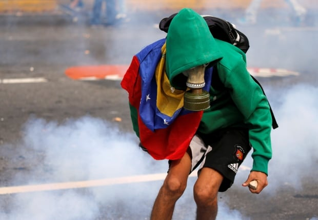 Intense photos show Venezuela being rocked by the 'mother of all protests'