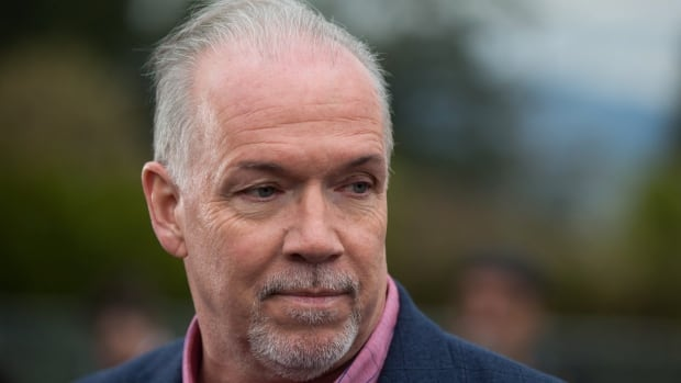 NDP Leader John Horgan listens during a campaign stop outside an elementary school in Surrey, B.C., on Wednesday April 19, 2017. A provincial election will be held on May 9.