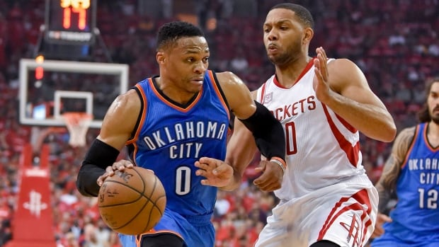 Oklahoma City Thunder guard Russell Westbrook (0) drives past Houston Rockets guard Eric Gordon during the first half of Wednesday's Game 2.