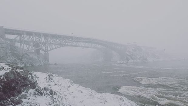 Light snow will end on Thursday, with high temperatures continuing below normal.