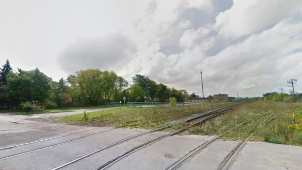 An elderly man's vehicle came to rest on these tracks Wednesday afternoon while a freight train moved toward it. The man was unhurt and his vehicle did not come in contact with the train.