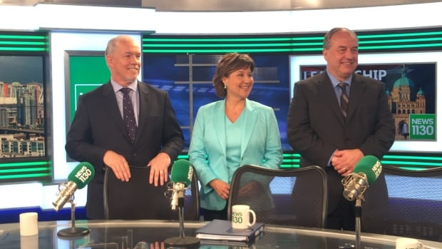 NDP Leader John Horgan, B.C. Liberal Leader Christy Clark and Green Party Leader Andrew Weaver pose for photos after first provincial leader's debate.