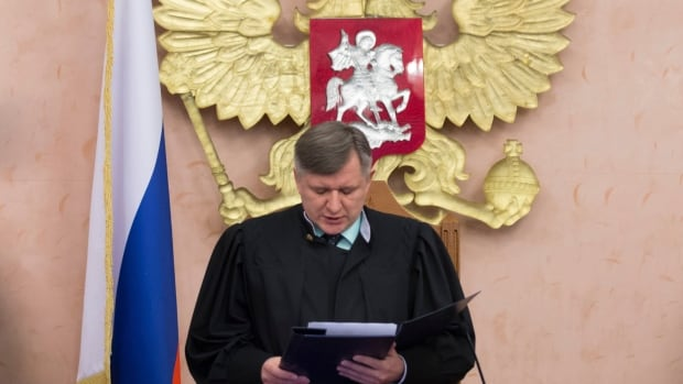 Russian Judge Yuri Ivanenko reads the decision to ban the Jehovah's Witnesses from operating in Russia in a courtroom in Moscow on Thursday.