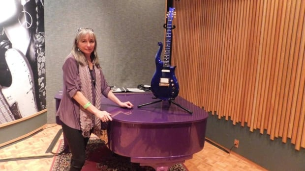Leslie Paulette toured Prince's Paisley Park recording studios last fall. Here she poses beside Prince's piano.
