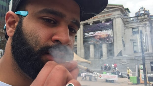 A pot smoker has a joint at the annual 4/20 day, which promotes the use of marijuana, in Vancouver. Cannabis shouldn't be used by young people, a medical journal editorial says.