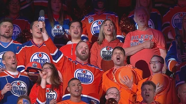 Oilers singer Robert Clark belts out the anthem at Rogers Place.