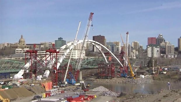 The 2,000-tonne central arch of the new Walterdale bridge was raised in April 2016. Its permanent height of 54 metres above the river, is about the same height as the High Level Bridge.