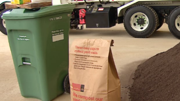 The city has about 7,600 green carts to get rid of after deciding to use a larger model, pictured, than was tried in the pilot program.