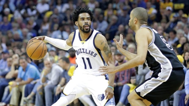 Grizzlies guard Mike Conley, left, guided his team to a resounding win over the Spurs on Thursday.