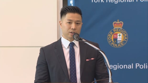 Det.-Sgt. Thai Truong, spokesperson for York Regional Police, explains to reporters that police put ads online to find men looking for sex.  The officers involved were undercover agents.