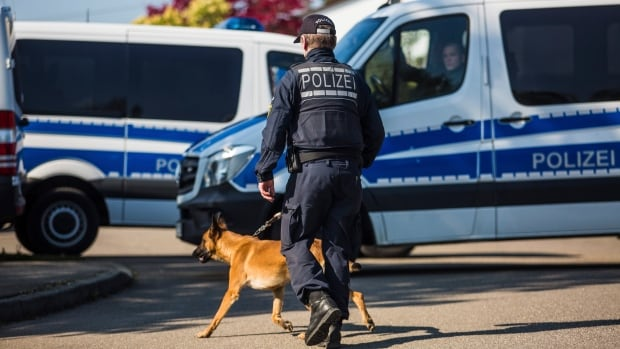 A police officer walks with a dog in Rottenburg am Neckar, southern Germany on Friday, where a suspect was arrested in connection to the bombing of Borussia Dortmund's team bus the week before.
