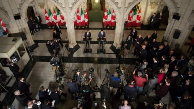 Canadian Prime Minister Justin Trudeau, centre right, and Italian Prime Minister Paolo Gentiloni, centre left, participate in a joint news conference in the foyer of the House of Commons during a visit to Parliament Hill in Ottawa on Friday, April 21, 2017.