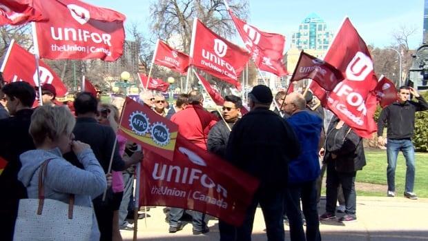 Union members gathered outside the Manitoba Legislature Friday.