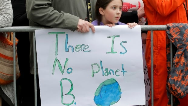 Demonstrators take part in a 'March For Science' demonstration in New York on Saturday. According to science, our spaceship Earth is facing dark clouds ahead, writes Bob McDonald.