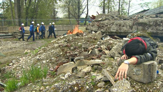 Volunteers posed as injured civilians for the mock exercise, held in Vancouver on Saturday.