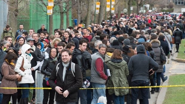 French expats wait in line to vote in Montreal on Saturday. France goes to the polls on Sunday for the first round of the 2017 French presidential election.
