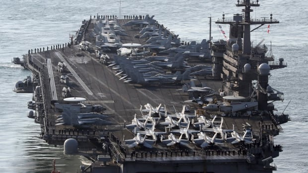 The Nimitz-class USS Carl Vinson aircraft carrier is one of very few its size in the world. It has begun drills with two Japanese destroyers in the western Pacific.