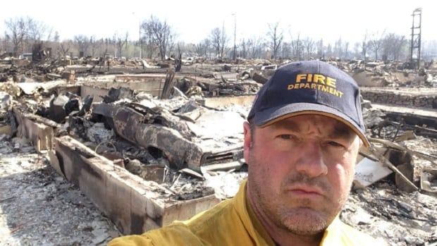 Mark Stephenson, a firefighter with the Fort McMurray Fire Department, watched his own home burn up in the wildfire.