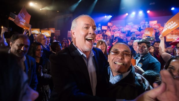 NDP Leader John Horgan greets supporters before speaking during a campaign rally in Vancouver, B.C., on April 23, 2017.