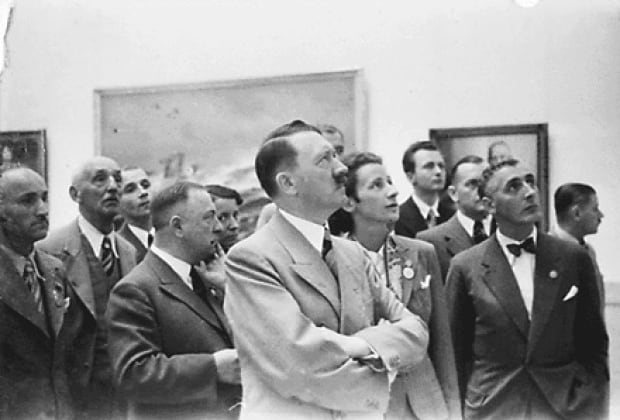 Hilter looking at art