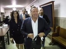 Journalist Megyn Kelly, left, has defended her interview with Infowars host Alex Jones, right, which is set to air Sunday on NBC.