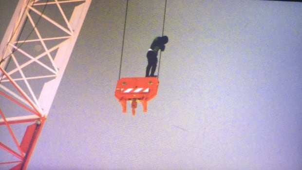 High drama as firefighters rescue woman atop crane in downtown Toronto