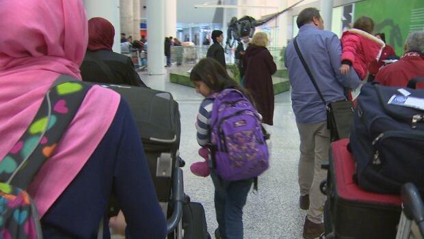 Family arrives in Toronto