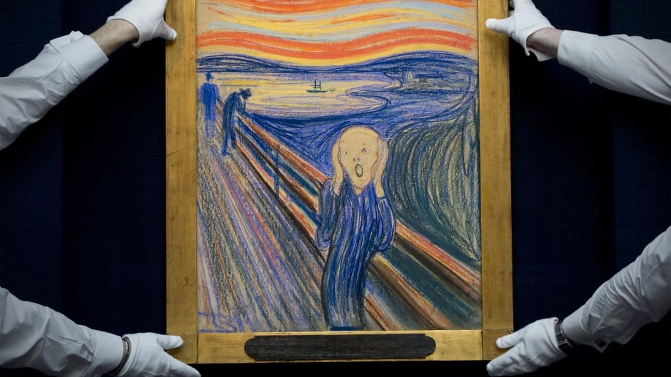 Sotheby's employees pose with Norwegian artist Edvard Munch's 1895 pastel-on-board version of The Scream at an auction house in central London on April 12, 2012.